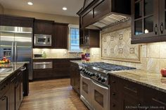 Kitchen With Dark Wood Cabinets...love the layout with the side by side double ovens