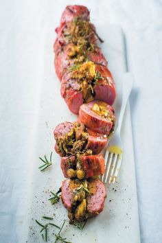 Fig, hazelnut and pesto-stuffed smoked pork fillet is the perfect combination of earthy, fresh and salty. The perfect quick and easy dinner for carnivores.