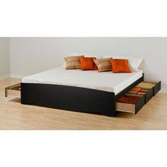 Platform bed with storage drawers built in. This is a great idea! You never have to worry about things falling under the bed if there is no under the bed!