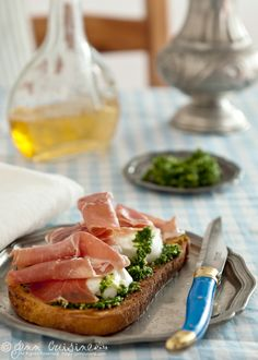 Bruschetta with Arugula Pesto, Mozzarella and Prosciutto
