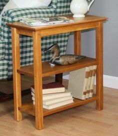 """Chairside Bookshelf by Manchester Wood: American Made Furniture. $199.95. American Made. Free Shipping. Handmade. Lifetime Quality. Solid Ash Hardwood. Ideal for narrow spaces between chairs, our Chairside Bookshelf combines the versatility of a small end table with the function of a bookshelf. It's a great space saver!  Dimensions: 11""""W x 23""""D x 24""""H  Comes fully assembled."""
