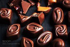 Chocolate candy background close up by nataliazakharova
