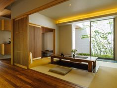 sliding doors of warm wood. Modern Japanese Interior, Modern Japanese Architecture, Traditional Japanese House, Japanese Interior Design, Japanese Home Decor, Home Interior Design, Japanese Living Rooms, Tatami Room, Japan Interior