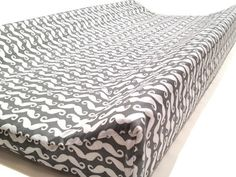 """Changing Pad Cover - you should have a few on hand at all times! Choose from variety of fabrics to make a perfect match to your nursery. Fits 32"""" x 16""""changing pad with both 4"""" contoured sides. Elasti"""