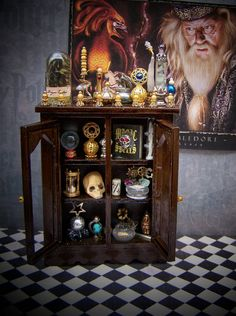 Potion Cabinet-- I would love to have something like this tucked away in my library:)