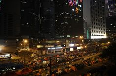 Umbrella Revolution Hong Kong, A building decorated with christmas lights is seen next to protest site at Admiralty on November 29, 2014 in Hong Kong, Hong Kong. The night before, pro-democracy protesters clashed with police forces on Sai Yeung Choi Street at Mongkok district, 28 people were arrested. (Photo by Alexander Koerner/Getty Images)