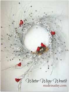 Made in a Day: Wispy Winter Wreath. I love the red birds against the white and silver wreath. This would be a quick project to make and I could keep it up all winter.