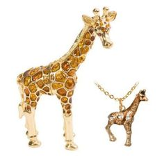 Giraffe Trinket Box by Jere Wright. $39.99. Meticulously hand-crafted from genuine brass. Strong magnetic closure. Gold plated with brown enamel and emerald crystals. Opens to reveal an antique gold epoxy interior. Bonus! Matching necklace included in box!. This collectible trinket box is hand-crafted with incredible detail using genuine brass and emerald Czech Preciosa crystals. Each crystal is hand-set, making every piece its own unique treasure. Shimmering gold plating and br...