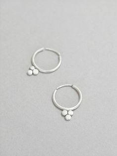 Small hoops earrings, boho, ethnic earrings, sterling silver, three dots, triangle dots, dainty hoops, minimalist design These earrings are made from sterling silver and are approx. 2 cm long. They are delicate and easy to wear every day. These earrings do not need an ear back. You pull them to the sides and close them the same way to keep the circle shape. Look at picture 4 and 5)  If you like this pair have a look here too…