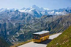 Switzerland. get natural. Postal bus at the Furkapass in Valais. View of the Grimselpass and the Finsteraarhorn (4274 m) in the distance.   Copyright by: Switzerland Tourism    By-Line: swiss-image.ch/Christof Sonderegger