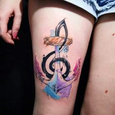 Very cool thigh tattoo. Anchor music watercolor.