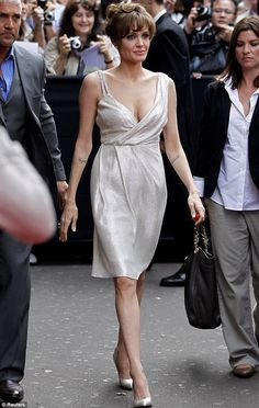 Ooh la la! Angelina Jolie looked stunning in a white sparkly Pamella Roland dress as she arrived at the Paris premiere of Salt