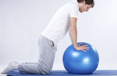 Man doing rehabilitation exercises on blue fitness ball