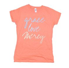"Grace, Love, Mercy (Coral) As a reminder of God's abundant blessings, this short sleeve, tapered missy-fit shirt says ""Grace. Love. Mercy."" in a bright design. Your purchase makes a statement and helps bring hope and restoration to the lives of the young women we serve."