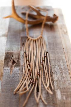 Hey, I found this really awesome Etsy listing at https://www.etsy.com/listing/270026570/boho-ivory-fringe-necklace