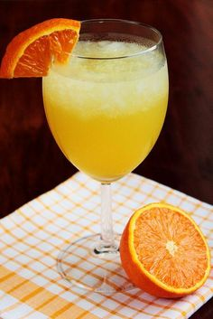 Tropical Vacation Cocktail..Yields 1 cocktail..1/3 cup pineapple juice 2 ounces Malibu Rum (or other coconut rum) 1 ounce Triple Sec (or other orange liqueur) 5-6 ice cubes In a blender, blend together all ingredients. Pour into a chilled glass, top with an orange or pineapple slice, and enjoy.