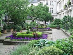 The private garden of the 600-year-old Draper's Company has raised beds and five mulberry trees.