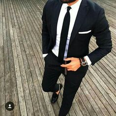 Two piece slim black suit.... Black knitted flat bottom tie, crisp white shirt and pocket square.