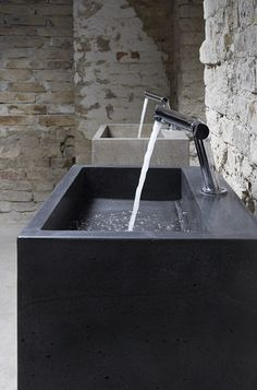 Washbasin made of concrete poured in one piece. Designer: Ildikó Buzogány.
