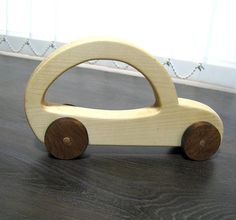 A wonderful toy for children from 1 to 3 years for pushing a solid wood. The toy is natural, unpainted. ----The car is made of pine wood, the wheels are made of acacia wood. Hand made in Bulgaria. ----Dimension: Length: 23 cm, 9 1/16 Width: 5 cm, 2 Height: 12.5 cm, 4 15/16 Weight: