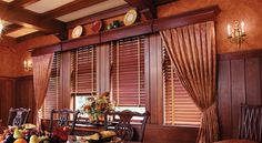 Wood blinds and cornices add richness to this dining room.