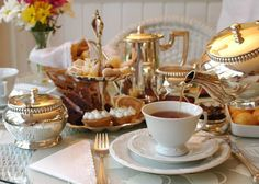 Tea being poured into a cup on a table set for afternoon tea Cream Tea, Tea Service, Chocolate Cheesecake, Tea Recipes, High Tea, Drinking Tea, Afternoon Tea, Tea Time, Coffee Time