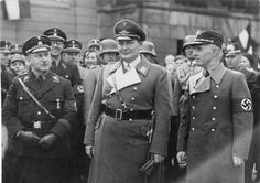 """Hermann """"Fatso"""" Goering, in his capacity as Prussian Prime Minister, presides over the inauguration of the new Potsdamer Mayor Major General Frederick (right). On the left is the Senior President of the Province of Brandenburg Kube, March 1934."""