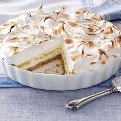 Lemon Meringue Ice Cream Pie Recipe -This pretty pie has it all—a graham cracker-pecan crust that's layered with vanilla ice cream and lemon curd and then frozen. Golden-brown meringue adds the finishing touch.—Dana Hinck, Pensacola, Florida