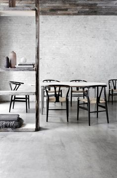 Black Wishbone Chairs by Hans Wegner with seats in handwoven natural paper cord.