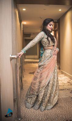 Sangeet Lehengas - Gold Sequinned Lehenga with Aqua Blue Detailing and Peach Net Dupatta | WedMeGood #wedmegood #indianbride #indianlehenga #gold #sequins #peach #lehenga #bridal #lehengas