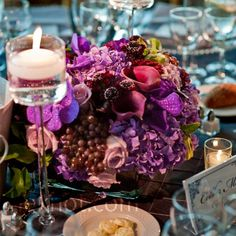 Champagne grapes added to arrangements of black dahlias, lavender roses, eggplant calla lilies and purple hydrangeas tied in the wine theme.