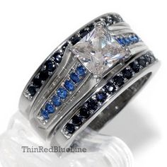 Style: Metal: Stainless Steel Stamp: Finish: Polish Color: Silver, Blue and Black Stones: Cubic Zirconias Center Stone Cut: Princess Cut Center Stone Police Wife Ring, Police Officer, Cop Wife, Police Life, Engagement Sets, Engagement Ring Settings, Silver Rings With Stones, Black Stones, Police Wedding