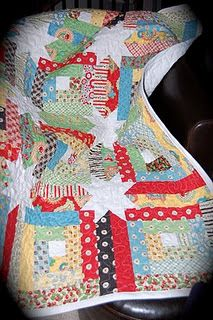 Mary Engelbreit cherry quilt, log cabin with pieced sashing to make the stars