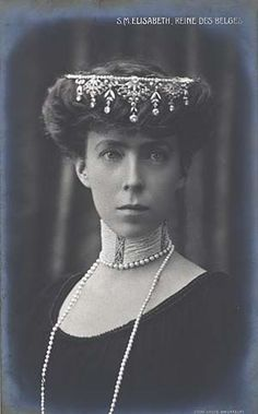 Queen Elisabeth of Belgium (aka Elisabeth of Bavaria) 1875 - 1965.    She was Queen from 1909-1934.    She certainly wears this tiara in a less-than normal way, but what an attractive and unusual face she has - rather severe, but this style suits her