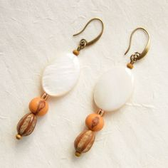 Brazilian Acai and Syringa Berrytree seeds and Oval Mother of Pearl Pucks Eco Friendly Earrings via LauraBijoux. Click on the image to see more!