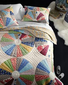 An heirloom-quality quilt brimming with vintage appeal, this contemporary update is reminiscent of the feedsack fabrics and circular designs popularized in the 1920s and '30s. The twist? Artfully oversized rounds that beautifully showcase the radiating patterns inside.