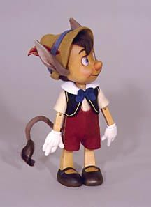 """R John Wright Dolls - Pleasure Island Pinocchio 9"""" hand carved Alpine maple with wool felt, fully jointed. Date of Release: 1992 Ltd. Ed. 250. Made exclusivley for the 1992 Disneyana Convention"""