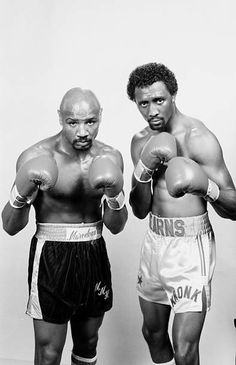 Thomas Hearns and Marvin Hagler pose for a promotional portrait. : Thomas Hearns and Marvin Hagler pose for a promotional portrait Thomas Hearns and Marvin Hagler pose for a promotional portrait. Kick Boxing, Bon Sport, Marvelous Marvin Hagler, Boxing Posters, Boxing Quotes, Boxing Champions, Sport Icon, Sports Figures, Sports Stars