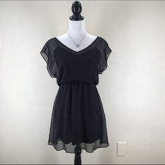 """Express Chiffon Black Dress A layer of semi-sheer chiffon attaches to a silky cami slip with elastic at the waist, with a hem that offers playful movement.  V-neck. Semi-sheer outer layer.  Cami slip lining; Attaches at elasticized waist Polyester Machine wash. Size-XS. Bust: 31.5-32.5"""". Waist: 24-25"""". Hip: 35-36"""". Length-30"""". Express Dresses"""