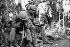 Vietnam War: Exhausted US Airborne troops during the fighting on Hamburger Hill (Hill 937) against heavily fortified North Vietnamese positions. US troops succeeded in capturing the hill, only to abandon it a short while later. The action caused an outrage both in the American military and public.U.S. losses during the ten-day battle totaled 72 KIA and 372 WIA. NVA casualties, claimed by the US, stood at 630 KIAs. Hill 937 was a watershed event of negative public opinion toward the VN war.
