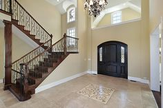 Upscale foyer in home with wood staircase Foyer Design, House Design, Foyer Flooring, Entrance Foyer, Curved Staircase, Construction, Hallway Decorating, Decorating Ideas, Decor Ideas