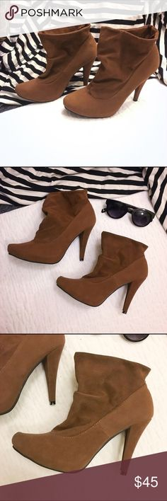 🔸NWT🔸N.Y. L.A. Brown Stiletto Booties Never worn, new! Very cute booties!          ✨Smoke and pet free home!✨                                  ✨Bundle and Save!                                                       ✨Make me an offer!                                       ✨Make sure to check out my 💝FREE with Bundle Items! 💝 NY L.A. Shoes Heeled Boots