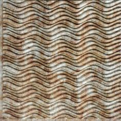 This ceiling & wall tile shows silver and gold colors mixed together for a 1-of-a-kind look. The wave can be placed vertically or horizontally to make a room look larger or taller depending on wave direction.