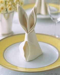 I'm not usually good at this kind of thing but, if you can, you should, everyone will appreciate it.  Bunny Fold for Napkins How-To