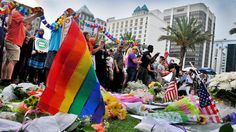 Pulse nightclub shooting:     People pay respect at a memorial during a vigil honoring the victims of a mass shooting at Orlando's nightclub Pulse, as they gather at the Dr. P. Phillips Center for the Arts in Orlando, Fla., Monday, June 13, 2016. (Craig Rubadoux/Florida Today via AP) MANDATORY CREDIT