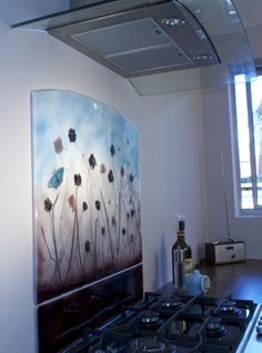 Field of Flowers handmade bespoke glass splashback with dichroic butterfly