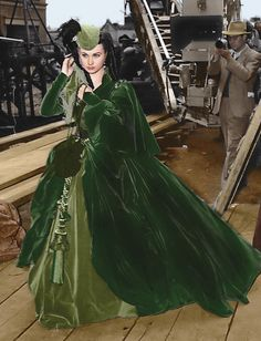 """British actress - Vivien Leigh, (1913-1967) Dressed in the green velvet """"curtain"""" ensemble, as Scarlet O'Hara. ~ Behind the scenes location - on the movie set for the film, """"Gone With The Wind"""", c.1939. ~ {cwlyons}"""
