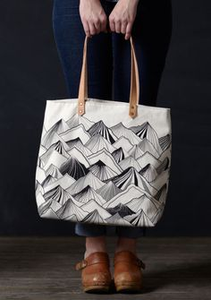 This tote bag is printed with our beautiful Mountain print. Details: Leather straps are riveted by hand with brass rivets. Eco: This tote is screen