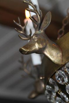 Reindeer chandelier in antique brass.