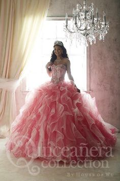 An enamoring ball gown made with glimmering bead appliqués on its classy corset bodice. The bodice provides all the essential facets to a beautiful Quinceanera gown with its regal boning, lace-up back